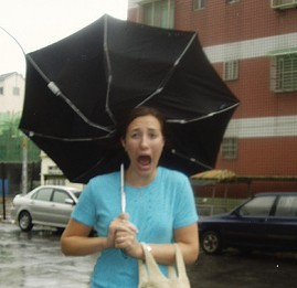 Funny photo of a woman with an inside-out umbrella