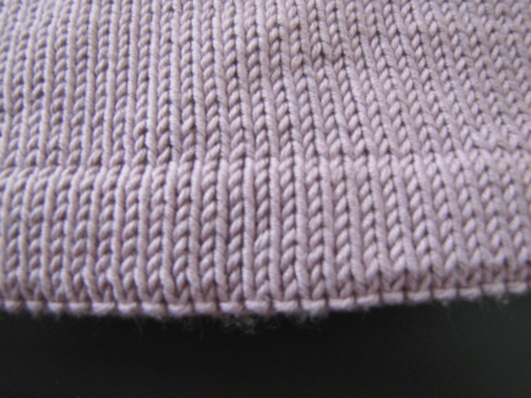 Closeup of a knitted hemmed edge