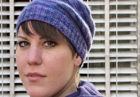 Liat modeling the Basic Magic Loop hat in purple - slouchy version