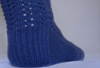 Blue lace sock with a slip-stitch heel