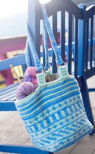 Fair-Isle felted bag shown hanging on bench