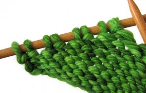 Swatch showing purl-side wraps, ready to be picked up