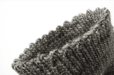 gray fingering-weight sock cuff with the picot hem bind-off