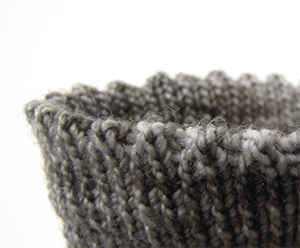 Gray picot hem bind off edge on a fingering-weight toe-up sock