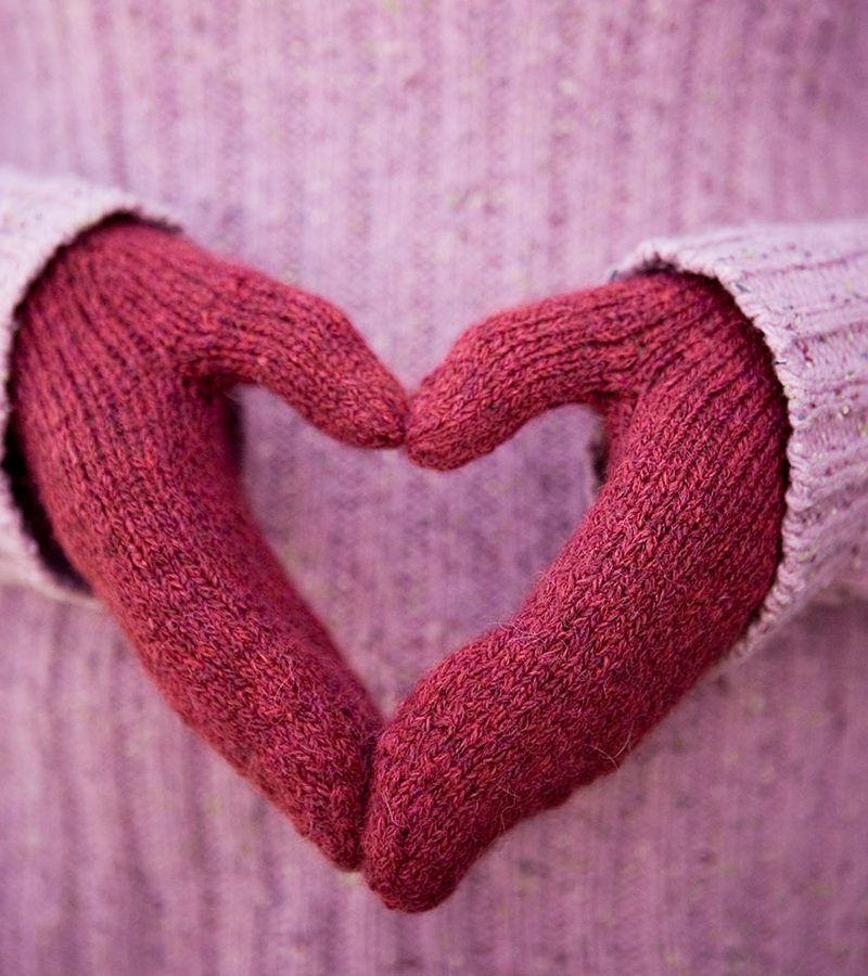 Red magic loop mittens with hands in a heart shape