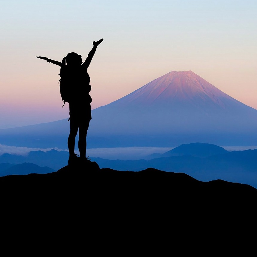Victorious Woman Standing on Mountain