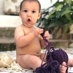 Baby Milo with Knitting Needles