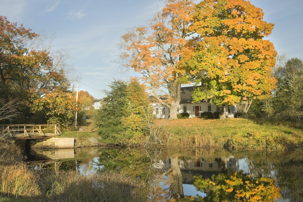 Country House reflected in lake