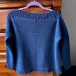 blue sweater on a hanger